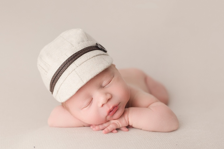 newborn baby in cap sleeping posed Ingersoll, Ontario