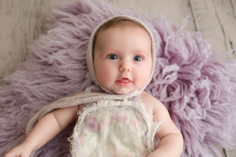 three month old baby girl in bonnet and outfit