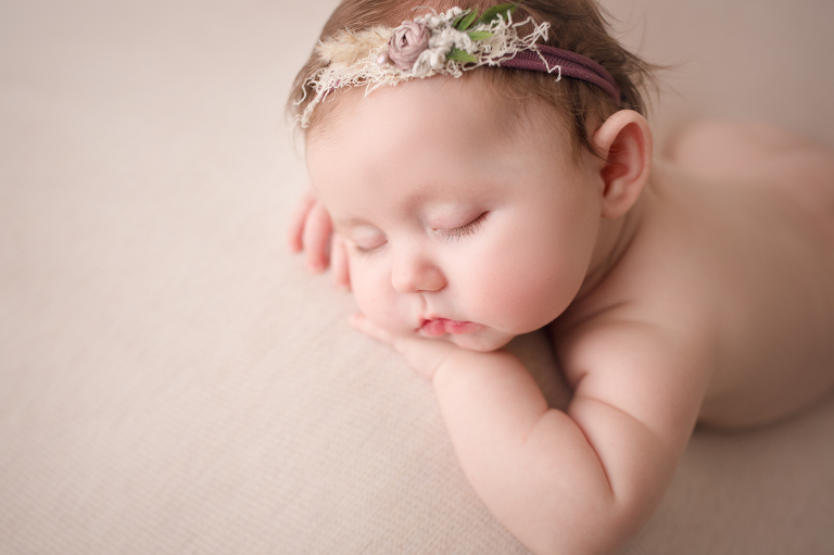 three month old baby girl sleeping posed in headband