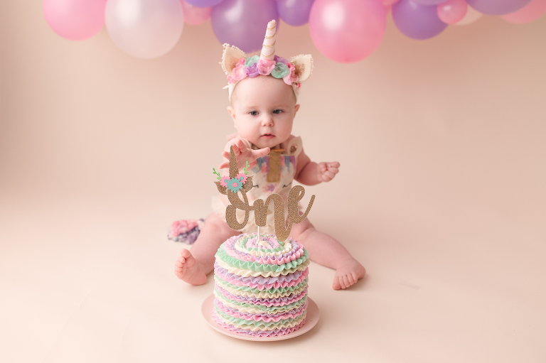one year old baby girl and cake